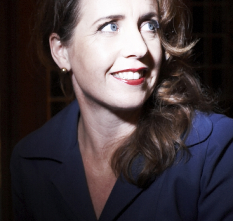 Margie Orford Author Photo by Brooke Fasani Close up smile looking right.jpg