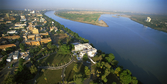 An excellent modern aerial view of Khartoum showing the Presidential Palace - on the site of the Governor's Palace of Gordon's time - and across from it the site of the North Fort, with Tuti Island in the background and the Nile in flood.