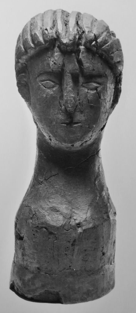 A wooden statue - probably representing a female ancestor - from the House of the Wattlework at Herculaneum (height 30.4 cm).