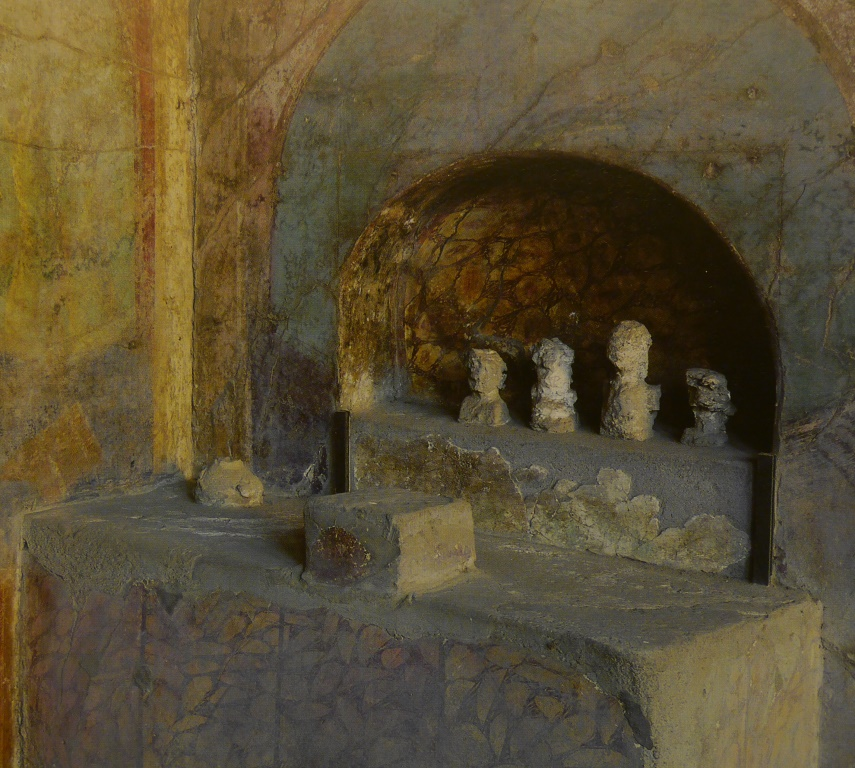 A shrine with crude images of ancestors from the House of the Menander, Pompeii.