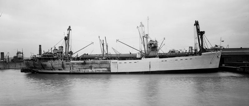 Assault Ship M.V.  Empire Elaine  on the Clyde in early 1943 being repainted in preparation for Operation Husky, the invasion of Sicily (National Maritime Museum collection).