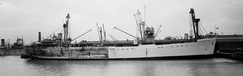 Assault ship Empire Elaine on the Clyde in early 1943, being refitted and repainted in preparation for Operation Husky.
