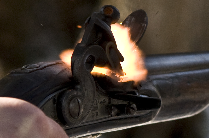 The instant that sparks from the flint ignite the priming powder in the pan. Click to enlarge (photo: Alan Gibbins).