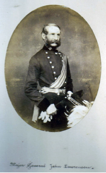 In this photo taken after his promotion to Major-General in 1860 he wears the ribbons of his two campaign medals (the Crimea Medal and the Turkish Crimea Medal) and two decorations (The Sardinian Medal for Valour and the Turkish Order of the Medjidie).