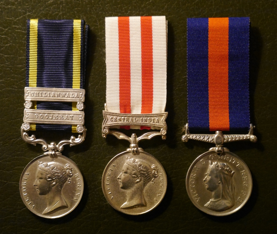 Captain Gordon's campaign medals: the Punjab Medal 1849 (with clasps Chilianwala and Goojerat), the Indian Mutiny Medal (with clasp Central India), and the New Zealand Medal.