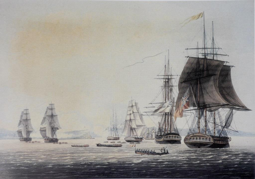 An 1817 aquatint of the British squadron at anchor off Oswego on 6 May 1814, based on a drawing by a Royal Marines officer present at the action, Captain William Steele. The frigate to the right, flying the broad pennant of Commodore Sir James Yeo, is HMS  Prince Regent , flagship of the squadron. The boats being rowed ashore are taking Royal Marines, sailors and soldiers to the assault of the fort atop the distinctive jutting promontory, visible amidst the smoke from the bombardment ( National Archives of Canada ).