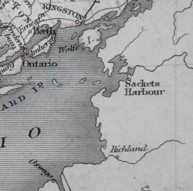 A 19th century map showing the eastern shore of Lake Ontario, with the entrance to the St Lawrence River dividing Upper Canada from New York State at upper right. At the top of the map is the Royal Navy base of Kingston, to the right the US Navy base of Sackets Harbour and at the bottom the US fort of Oswego, site of the British assault on 6 May 1814. The distance across the lake from Kingston to Oswego is about 45 nautical miles.