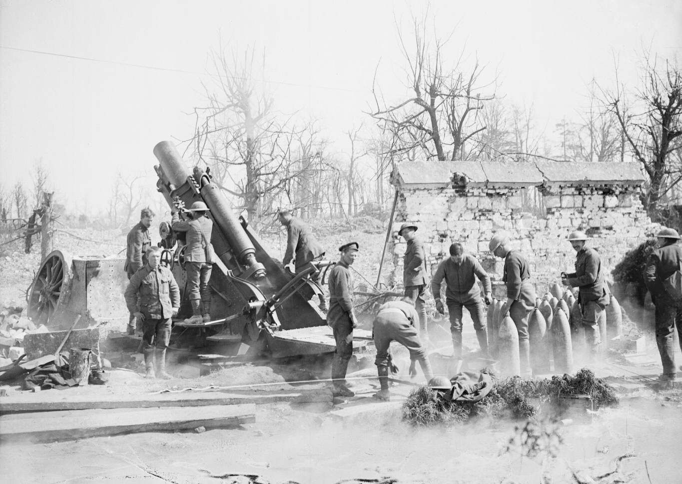 A 9.2 inch howitzer of the Royal Garrison Artillery in action in the ruins of Tilloy-les-Mofflaines, near Arras, April 1917 (photo: Lieutenant John Warwick Brooke, © IWM (Q 5221)). These photos of 9.2 inch howitzers and  the film  show the large box filled with earth on the same platform in front of the howitzer that was used to counterbalance the recoil; this was one reason why the 9.2s were so accurate. In harsh winter conditions they were sometimes filled up with water instead, and if the Battery had to move quickly they were often left behind or blown up as they would take too long to empty.