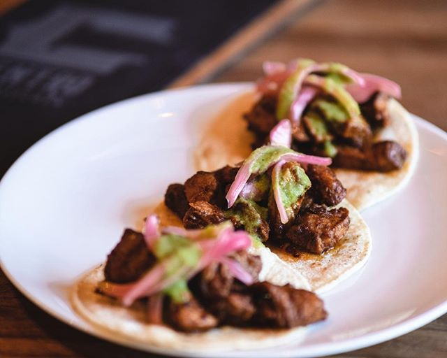 Our tasty tacos this week are roasted pork marinaded in a chipotle and roasted pineapple sauce with pickled onions and a drizzle of pinapple yogurt sauce. Available all week and as part of our $5 Happy Hour Plates Monday through Friday 3-6 PM.