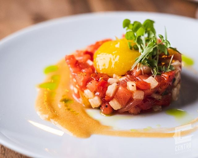 "Our Watermelon ""Tartar"" is a unique and delicious way to eat your fruits and veggies while the warmer weather lasts. It looks like tartar, but we loaded ours with roasted tomato, bell peppers, cucumber, jicama, mango, peach puree, chive oil, and bronze fennel."