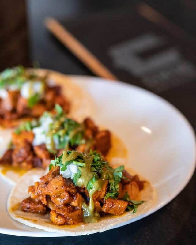 Tacos Al Pastor with cilantro, onions, and salsa verde this week for our weekly tacos. Grab some for $5 as part of special Happy Hour plates Monday through Friday 3-6P.