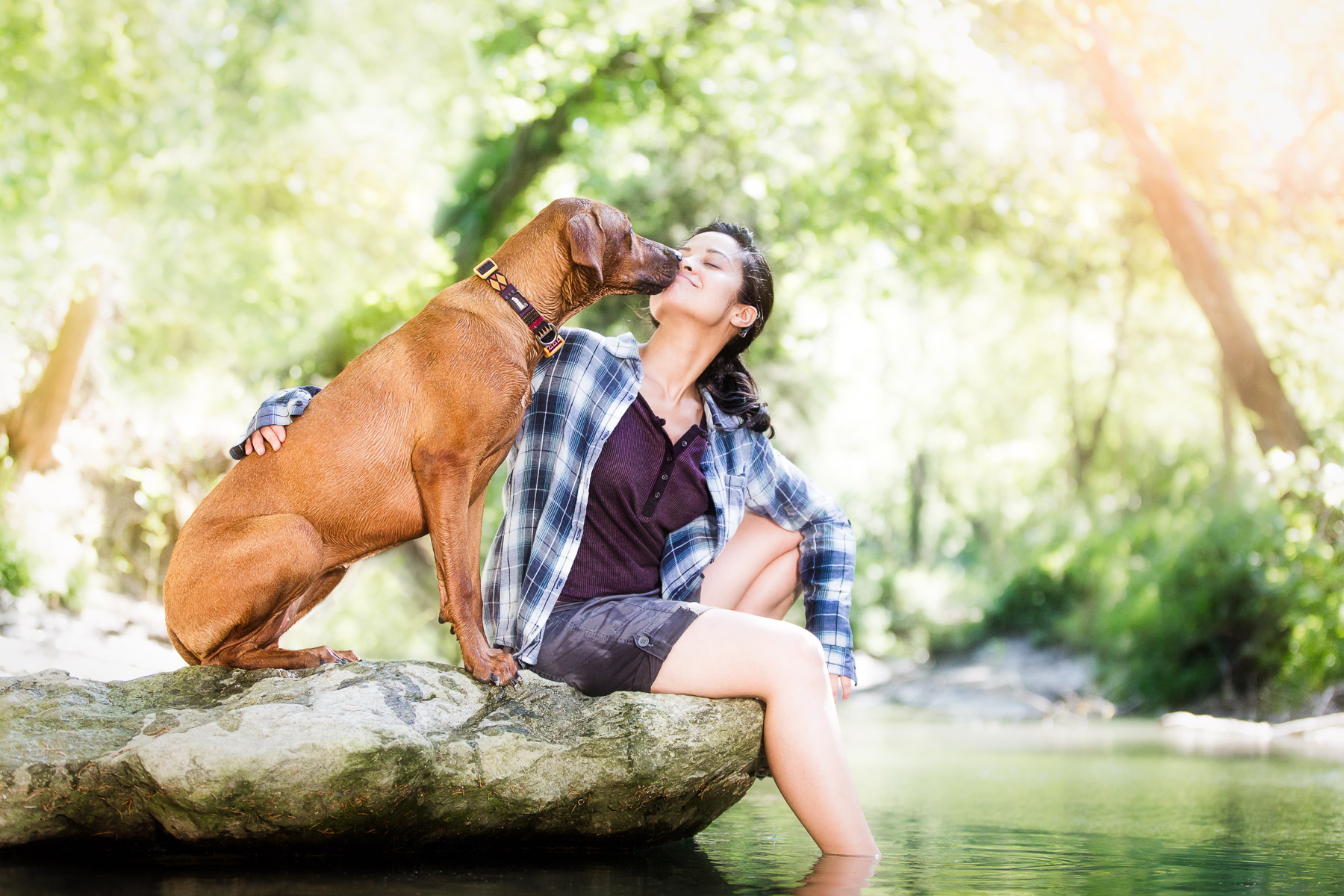 commercial-animal-photographer-dog-hiking-with-girl-creek-river.jpg