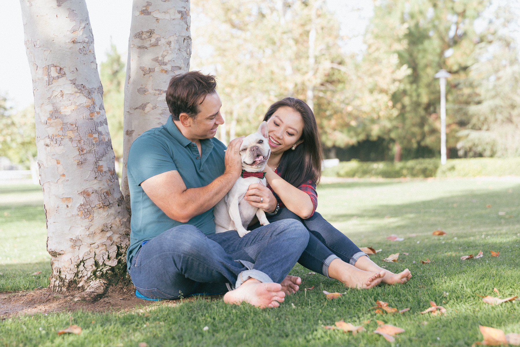 couple-with-dog-outdoors-parc-having-fun-with-dog.jpg