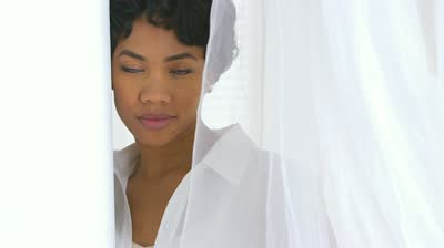 stock-footage-close-up-of-black-woman-behind-sheer-curtains-blowing-in-wind.jpg