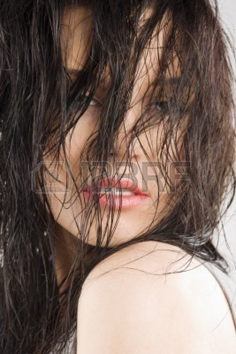 7440334-young-and-sensual-brunette-covering-face-with-wet-long-hair-and-looking-in-camera.jpg