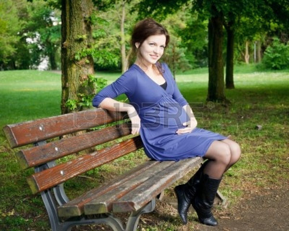8092960-beautiful-pregnant-woman-sitting-on-bench.jpg