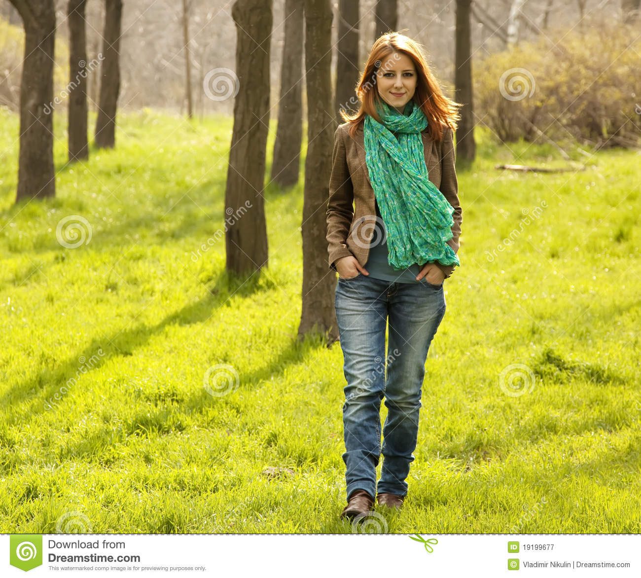 beautiful-girl-walking-green-grass-park-19199677.jpg