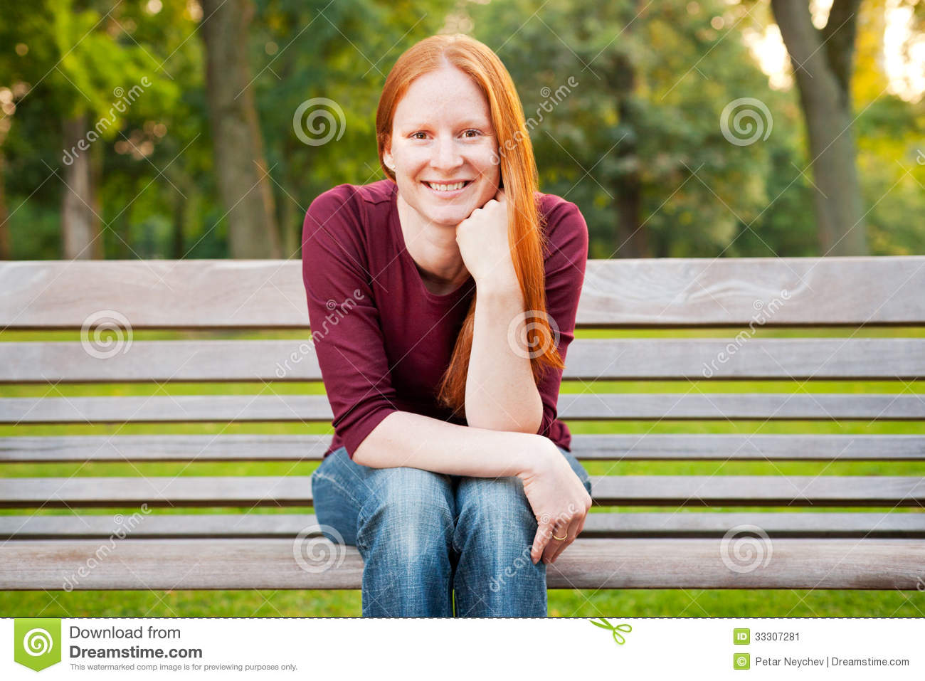 happy-woman-sitting-bench-young-caucasian-smiling-camera-33307281.jpg