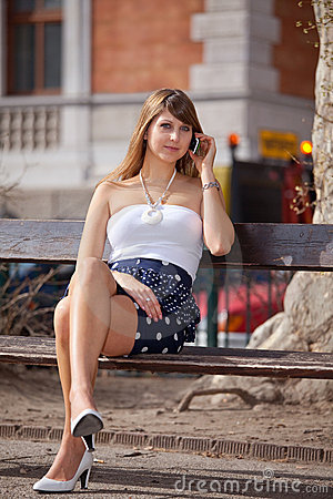 lady-relaxing-park-bench-13855632.jpg