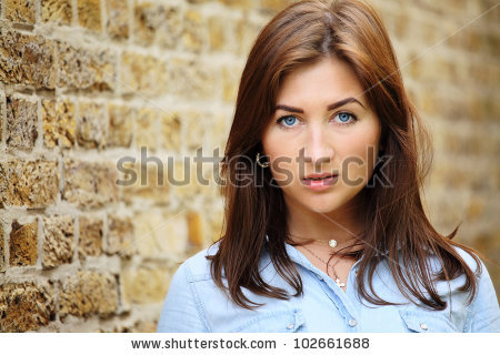 stock-photo-portrait-of-a-beauty-against-brick-wall-102661688.jpg