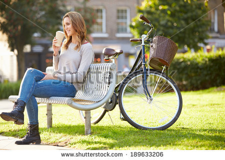 stock-photo-woman-relaxing-on-park-bench-with-takeaway-coffee-189633206.jpg