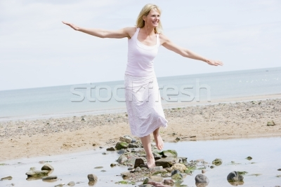 95202_stock-photo-woman-walking-on-beach-path-smiling.jpg