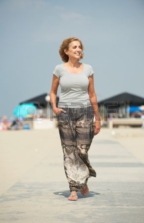 21644656-portrait-of-a-beautiful-older-woman-walking-at-the-beach.jpg