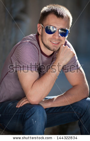 stock-photo-handsome-trendy-man-in-fashion-sunglasses-in-casual-wear-posing-on-city-street-in-summer-stylish-144322834.jpg