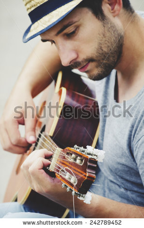 stock-photo-man-plays-the-guitar-on-the-street-retro-style-242789452.jpg