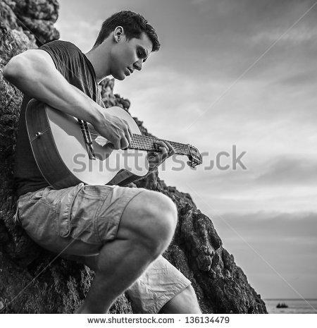 stock-photo-romantic-man-play-on-classic-guitar-black-white-photo-136134479.jpg