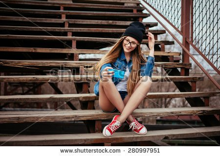 stock-photo-young-sexy-blonde-hipster-woman-posing-for-selfie-and-laughing-wearing-jeans-jacket-hipster-black-280997951.jpg