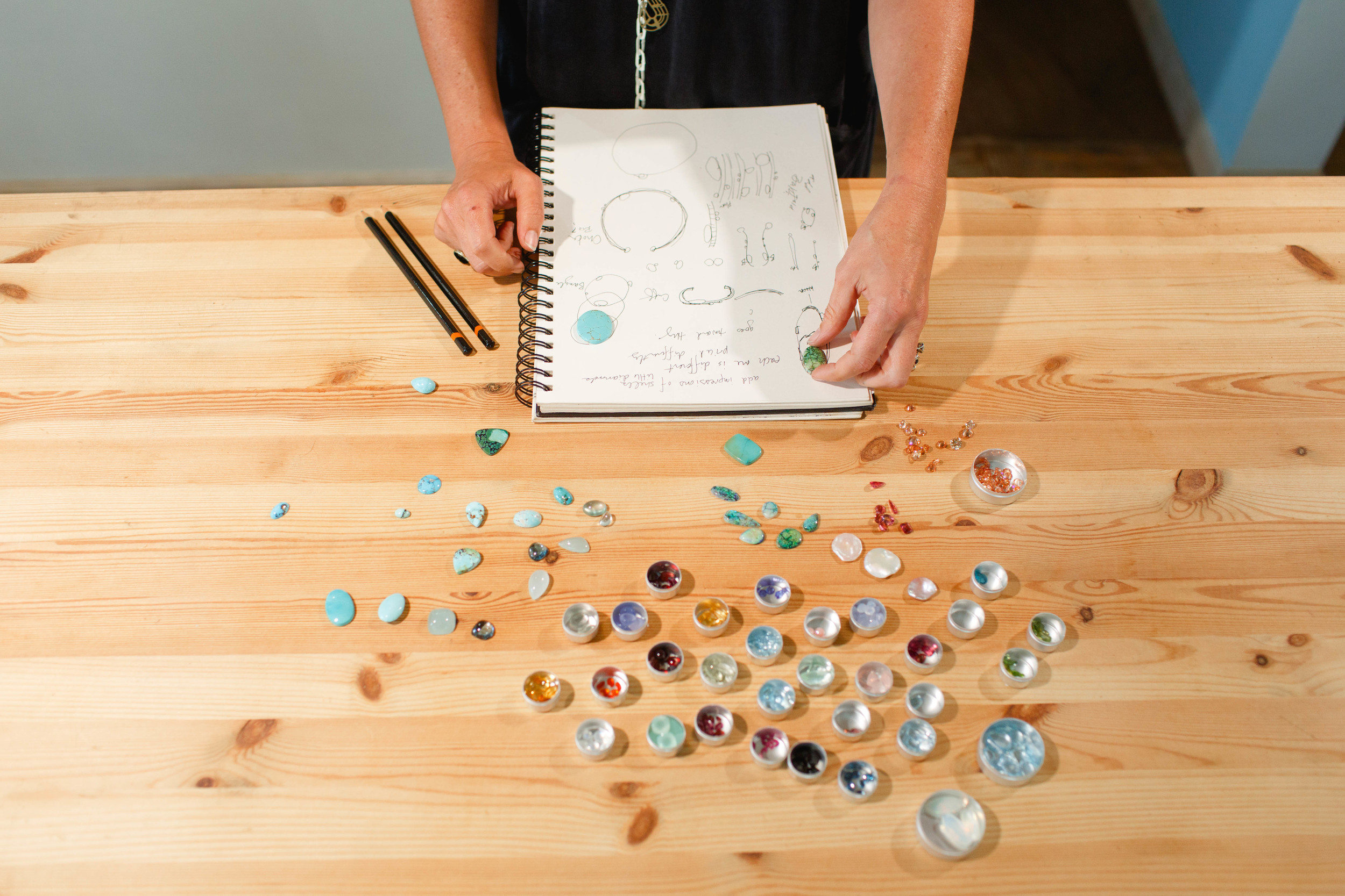 Working from her sketchbook, Heidi selects stones to complete her original designs.