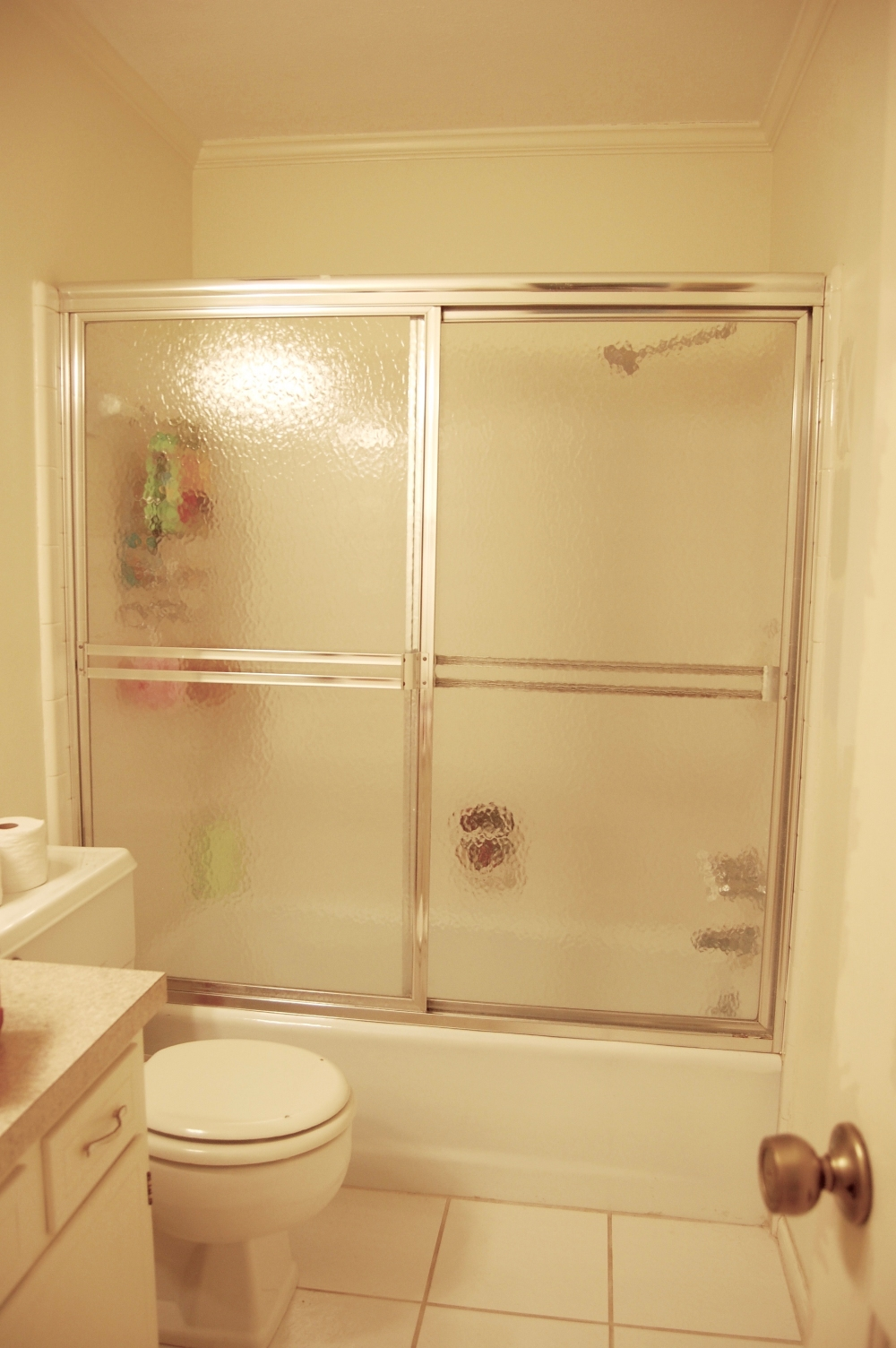 Before:  Ugly, gross, impossible to clean framed sliding shower doors.