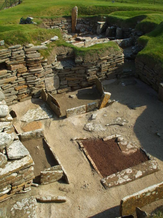 Excavation of the Skara Brae. The toilet room is the opening in the upper right of the home. It is thought to be one of the first examples of a toilet with a drainage system.