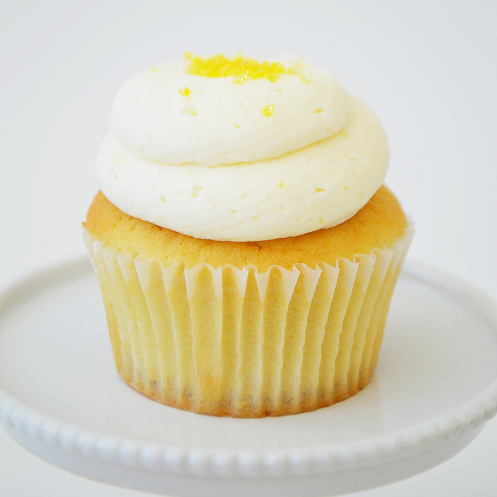Lemon Cupcake  - Lemon cake topped with lemon buttercream and yellow sparkling sugar.