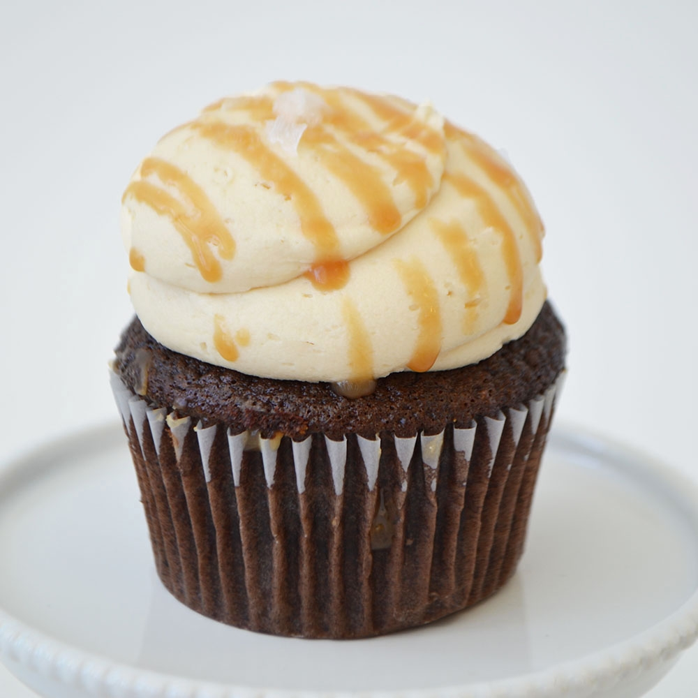 Salted Caramel Cupcake  - Chocolate cake topped with salted caramel buttercream, drizzled with caramel and sea salt.