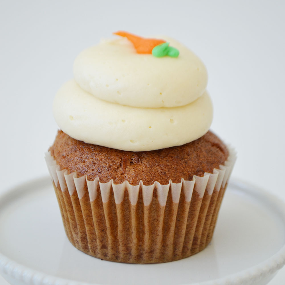 Carrot Cake Cupcake  - Lightly spiced carrot cake topped with cream cheese icing.