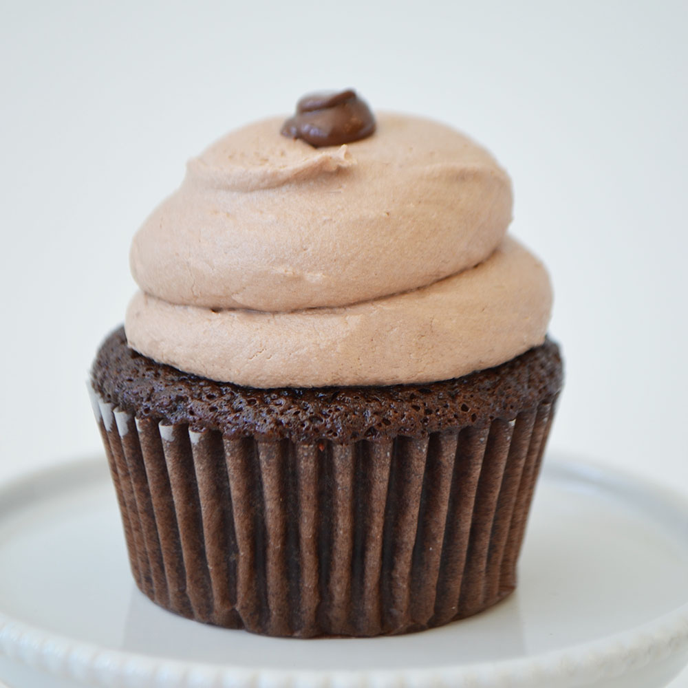 Nutella Cupcake  - Moist chocolate cake filled with Nutella, topped with Nutella buttercream and a Nutella dollop.
