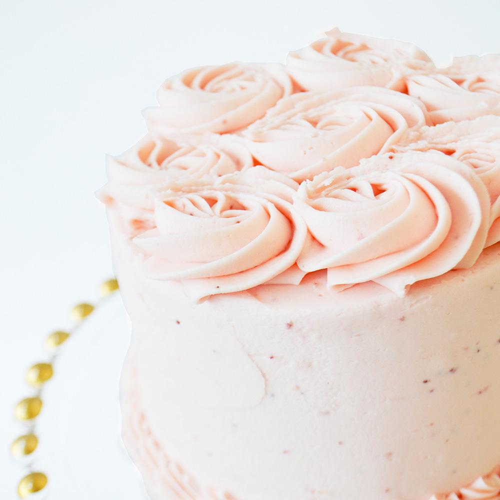 Strawberry Cake  - Strawberry cake layered between real strawberry buttercream and fresh strawberries.