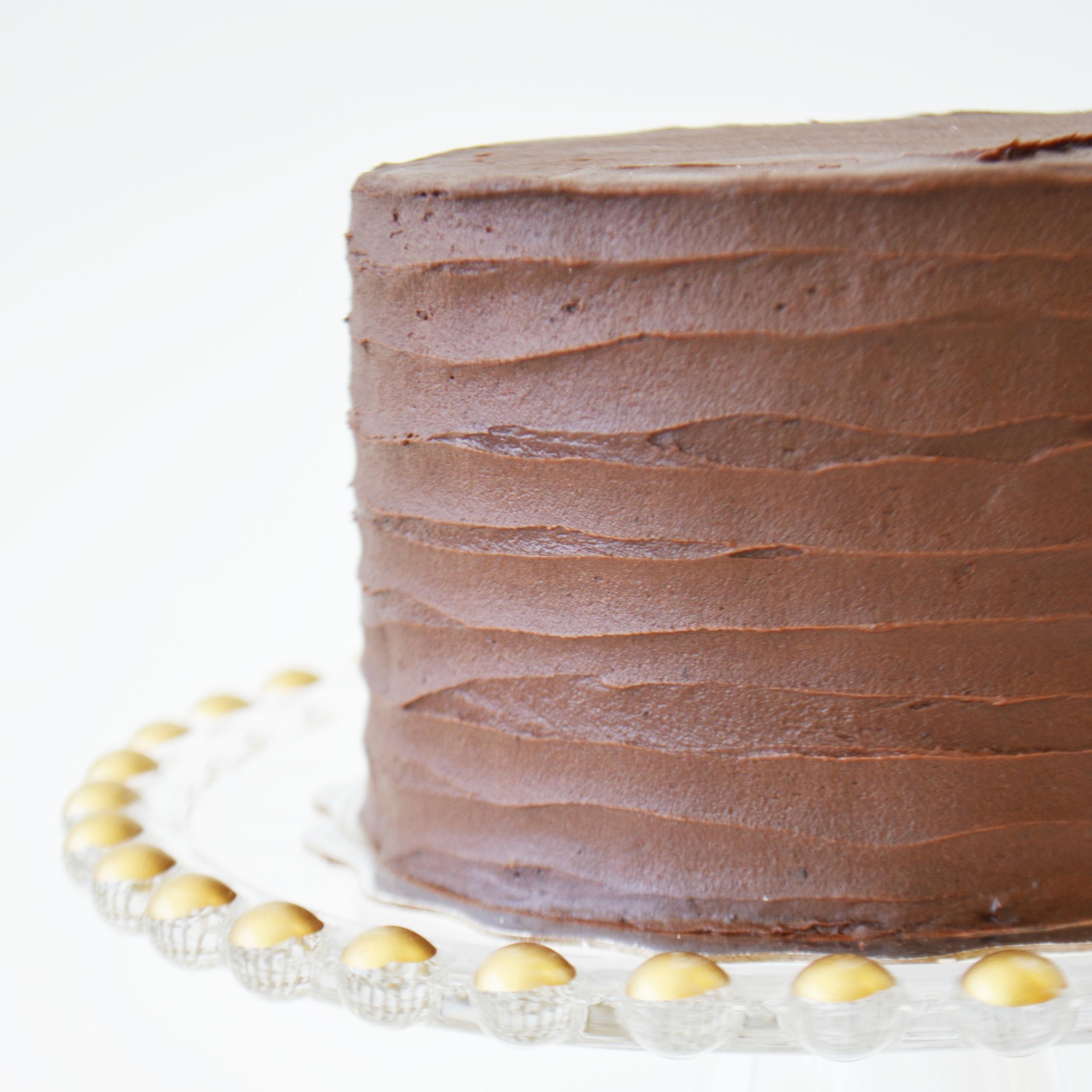 Chocolate Cake  - Moist chocolate cake layered with rich chocolate buttercream icing.