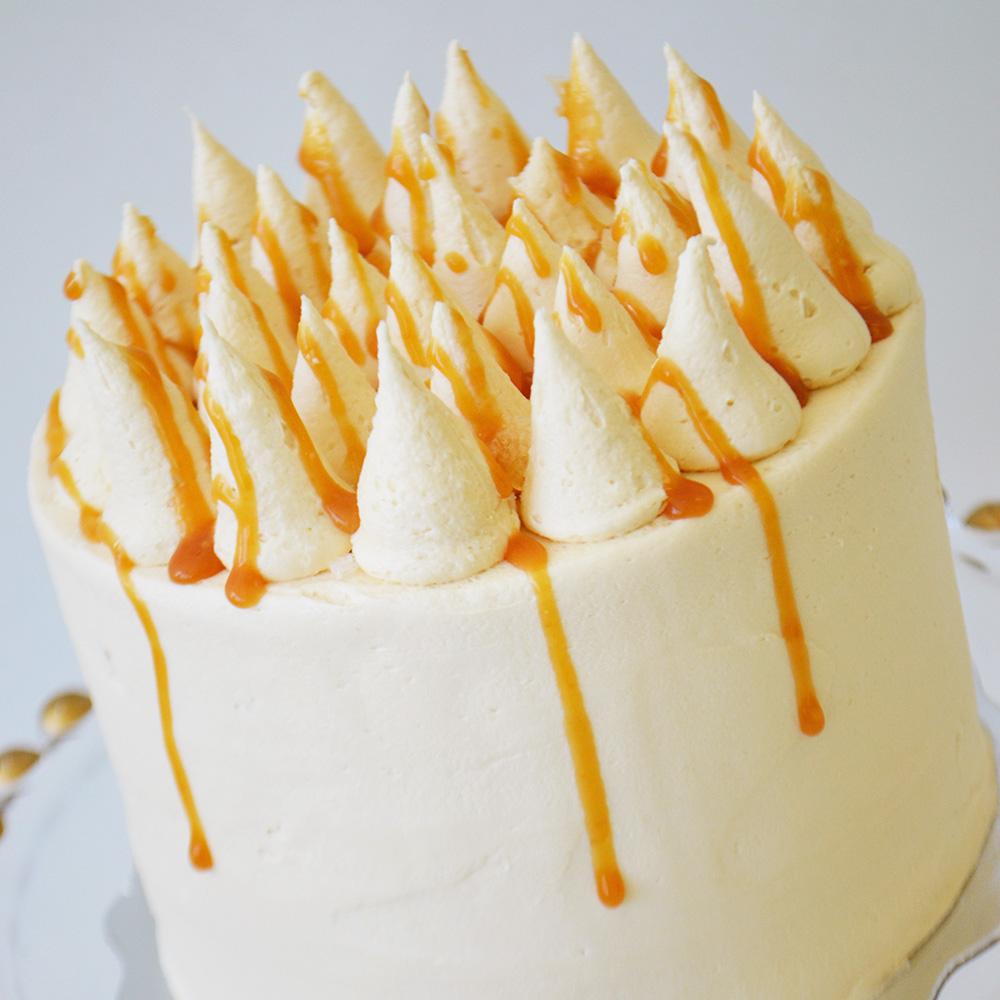 Salted Caramel Cake  - Chocolate cake layered with salted caramel buttercream, drizzled with caramel and sea salt.