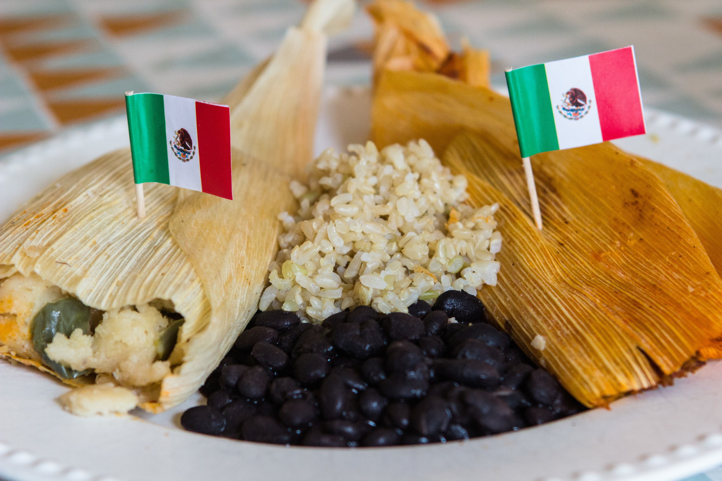 Tamales, rice, and beans