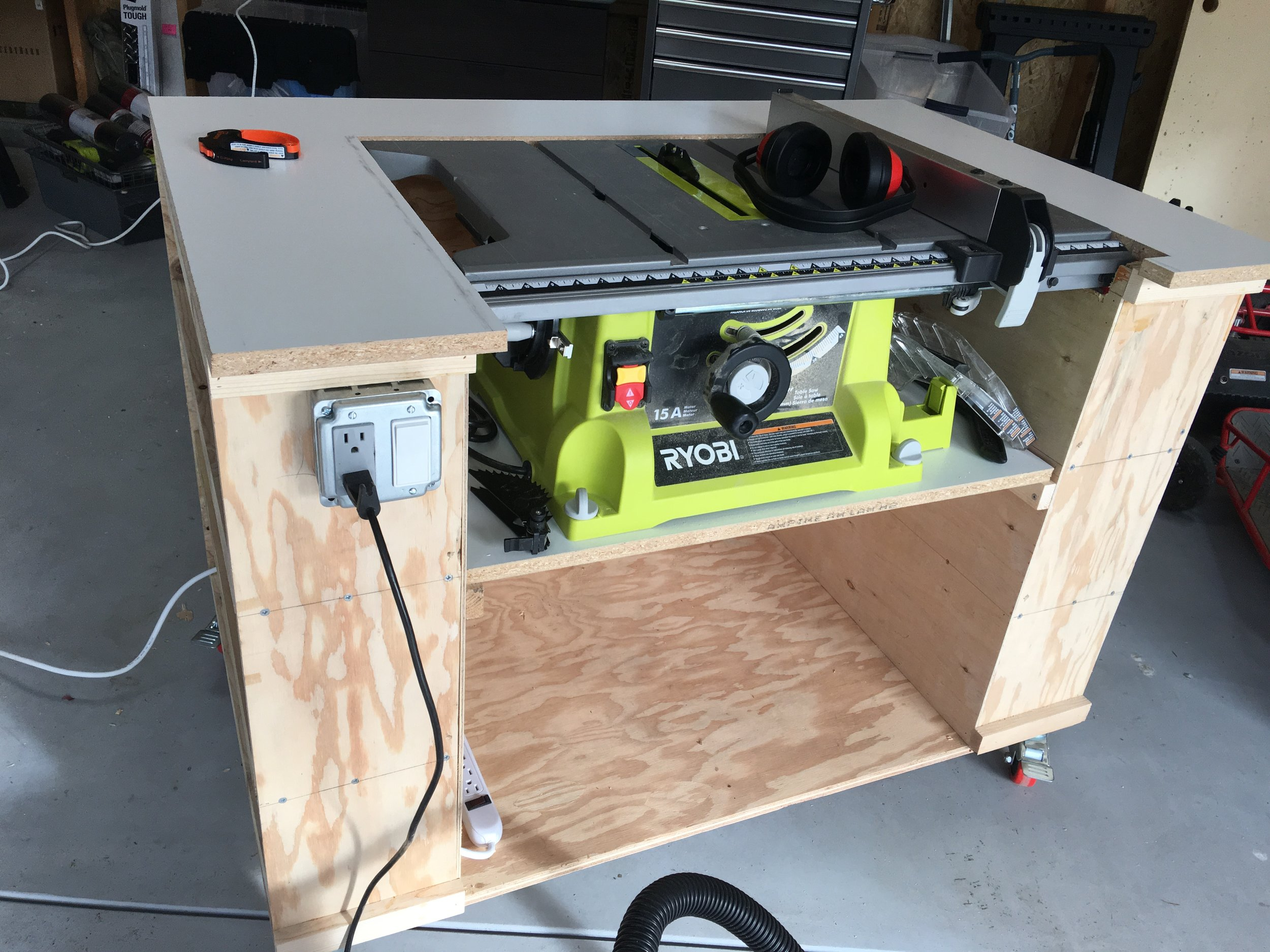 Added switch and outlet to front to control power to the saw.