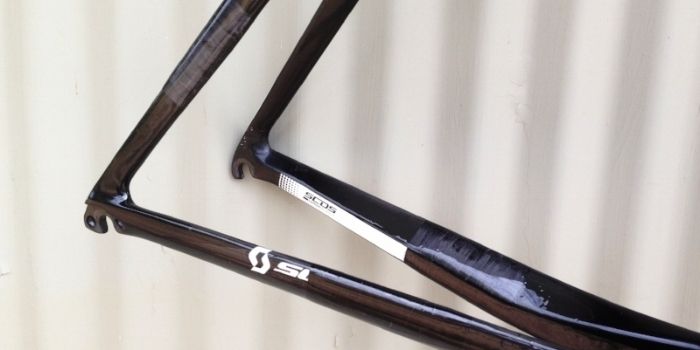 Carbon fiber repairs on the seat and chainstays of a Scott Foil road bicycle.