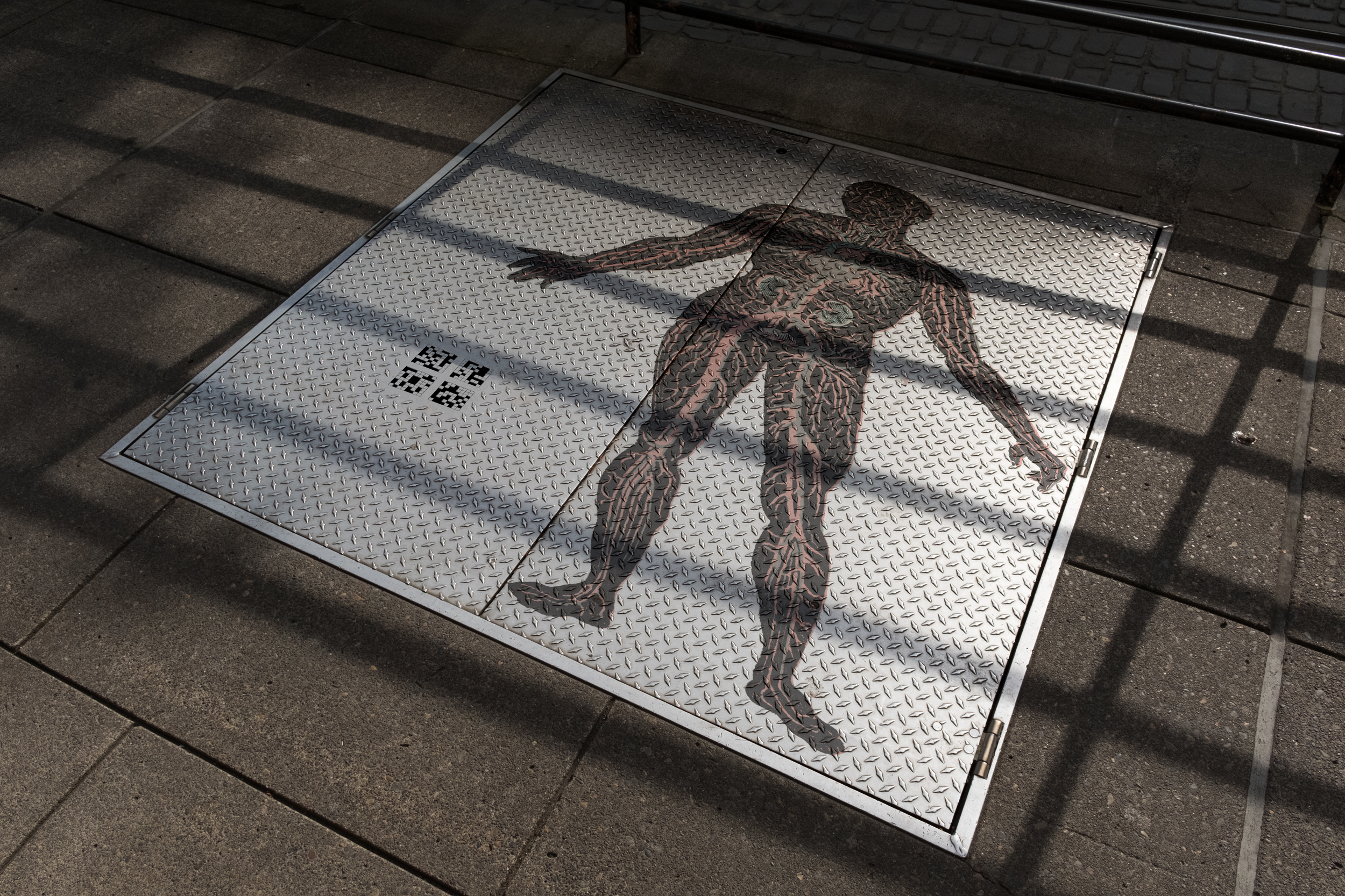 Metal Plate on Sidewalk with Leg copy.jpg