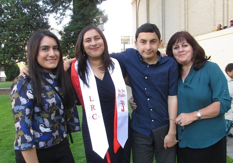 Camila (left) with her sister, brother, and mother