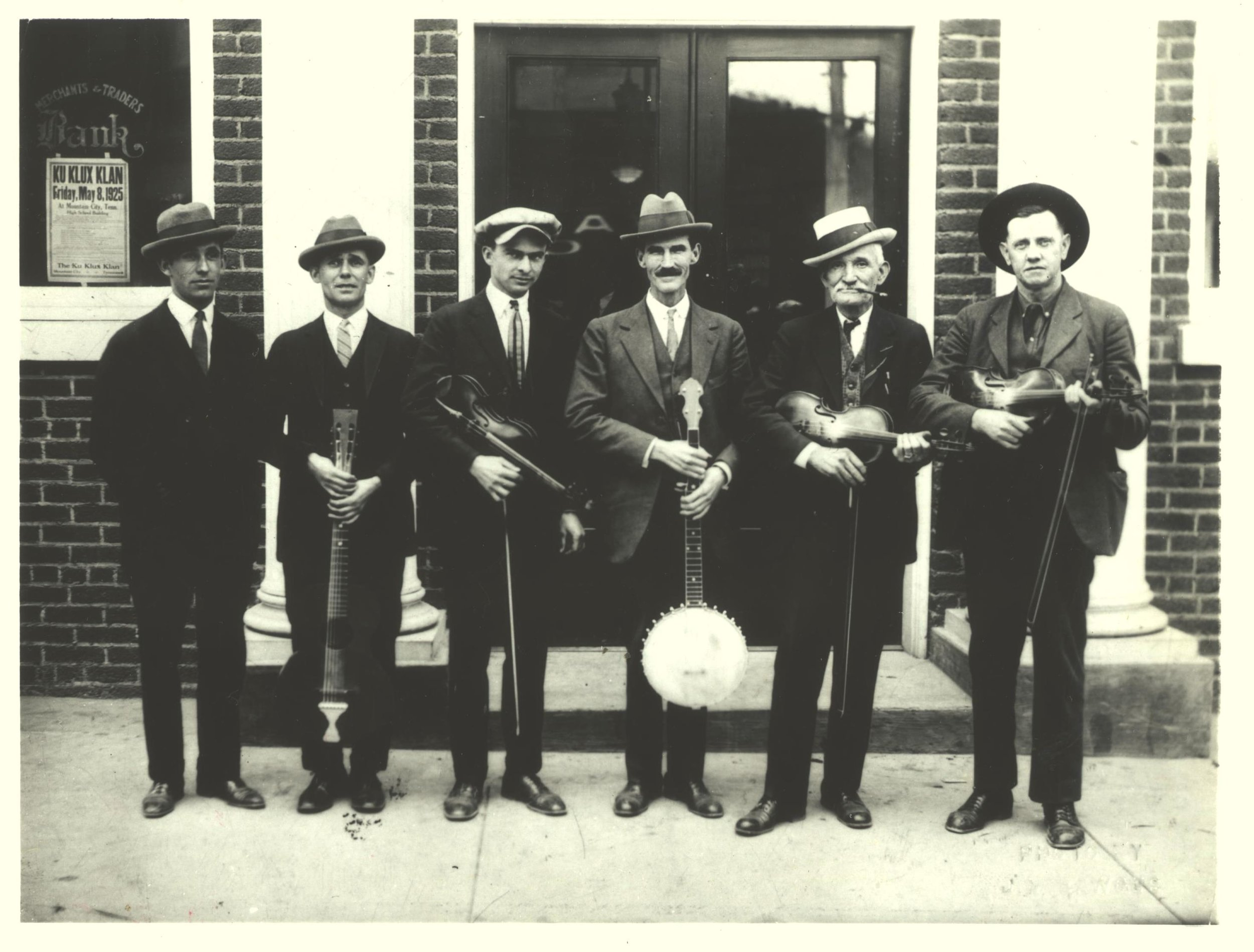 "Stuart, second from right, at the Fiddlers' Convention in Mountain City, Tennessee, May 1925. Also pictured, L to R: Al Hopkins, Joe Hopkins, Alonzo Elvis Alderman, John Rector (the ""Hill Billies""), and Fiddlin' John Carson. Southern Folklife Collection, Wilson Library Special Collections, UNC."