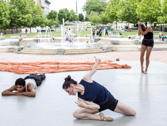 Julia Eisen, center, rehearses a scene for Terpsicorps Theatre of Dance in Pack Square Park in June.(Photo: Katie Bailey/bkbailey@citizen-times.com)