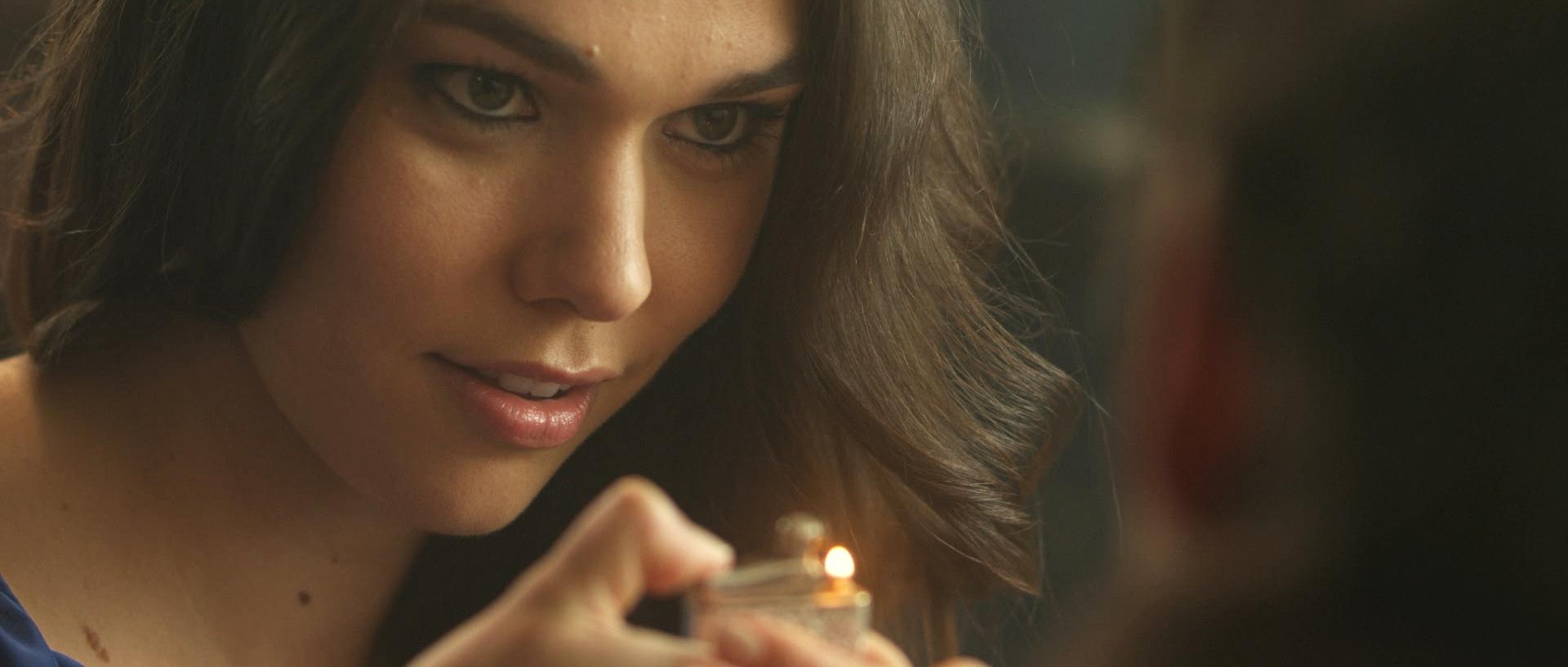 Kelly holding lighter.jpg