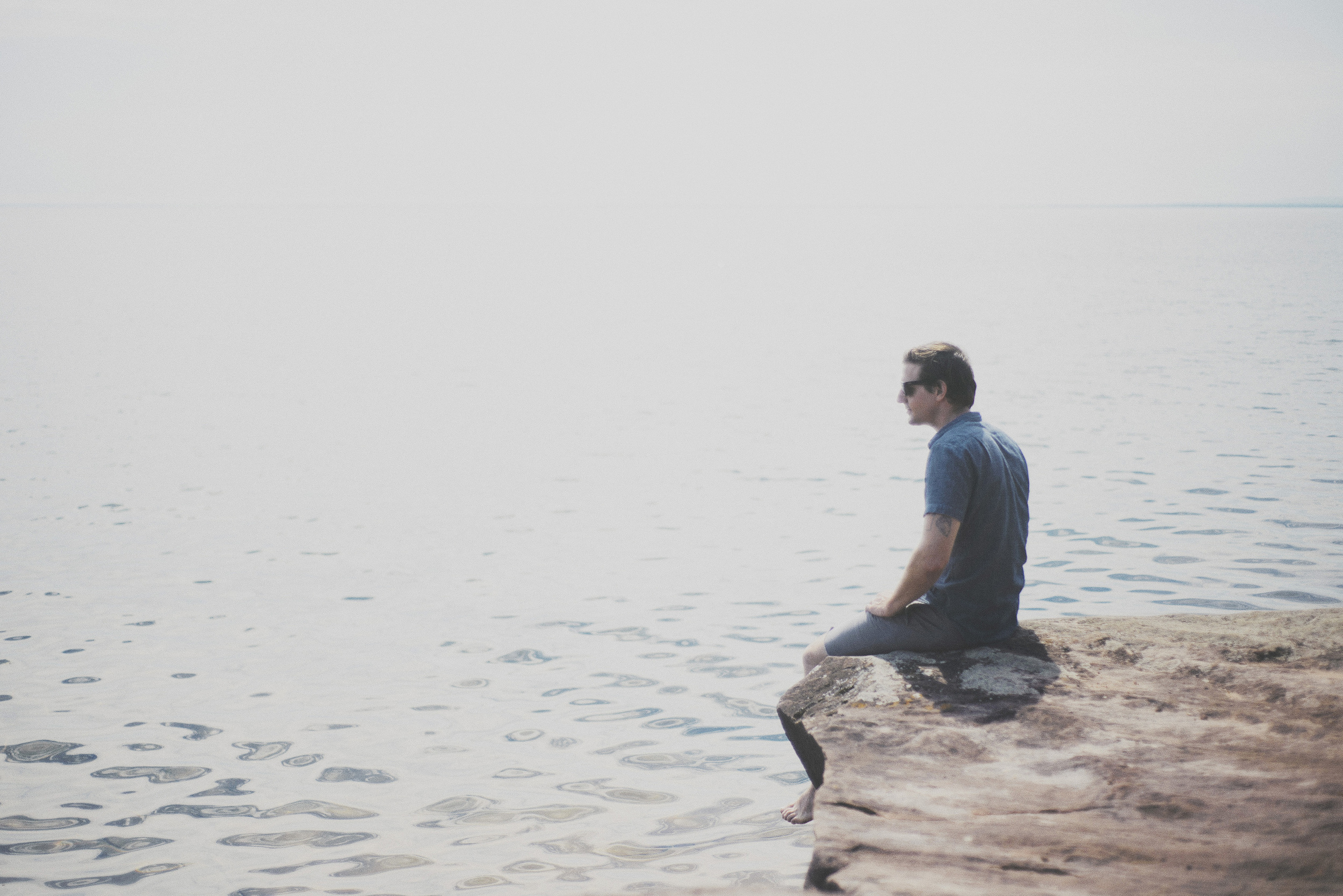 Our host, Joel, on Madeline Island. We had a picnic and drank champagne on these rocks. It was pretty epic. (: